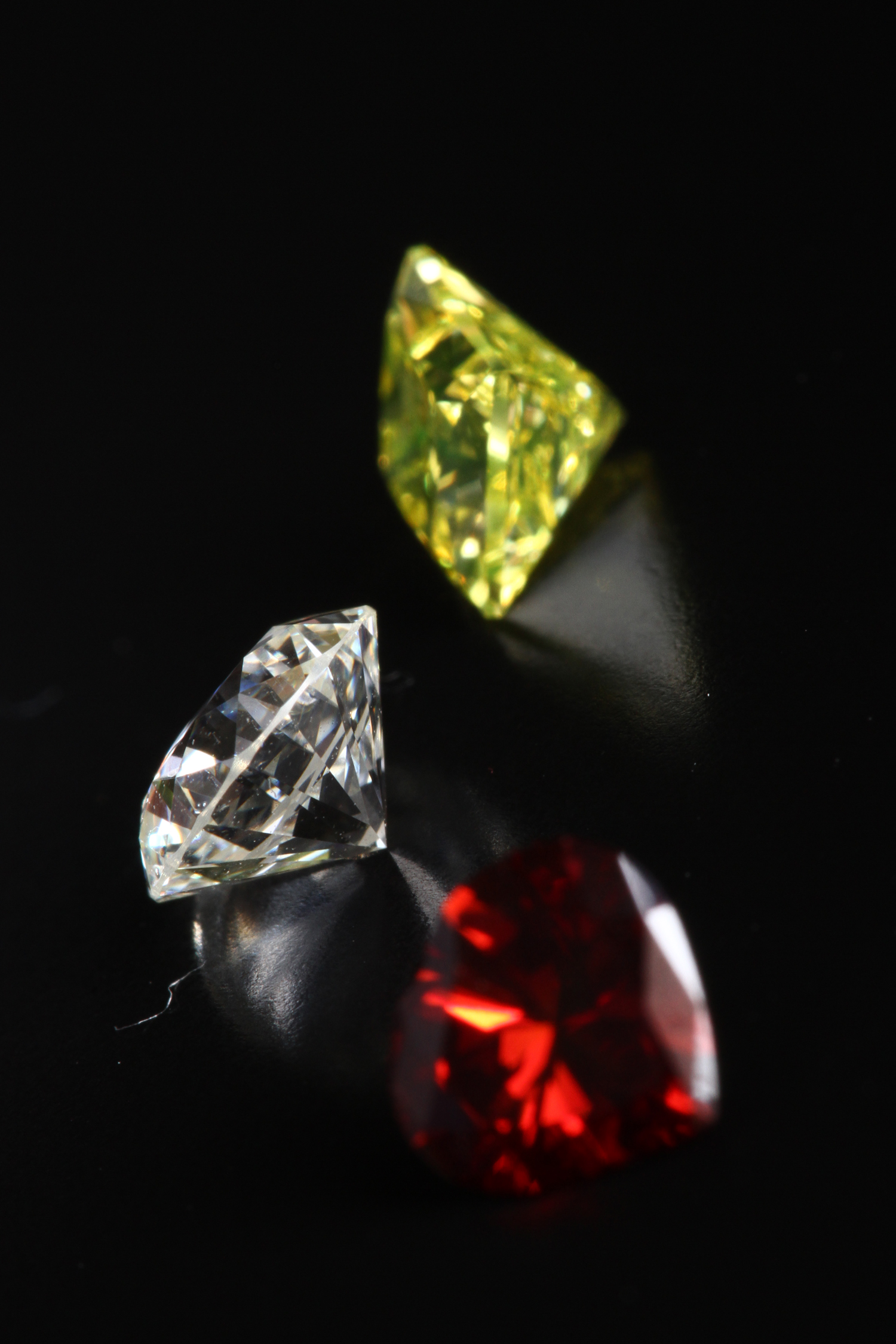 three cremation diamonds in yellow, white and red
