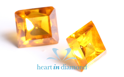 Two cremation diamonds graded using the four C system