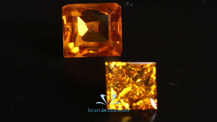 two orange cremation diamonds