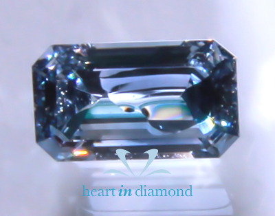 Blue emerald cut diamond from heart in diamond
