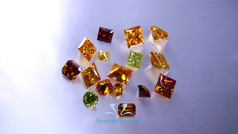 About 15 different types, shapes and colors of diamonds made from ashes