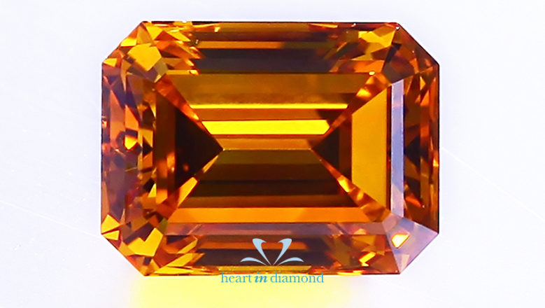 Large image of emerald cut orange diamond made from human ashes