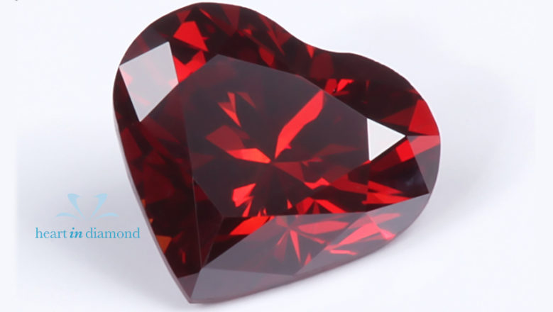 Heart cut diamond in red with the heart in diamond logo