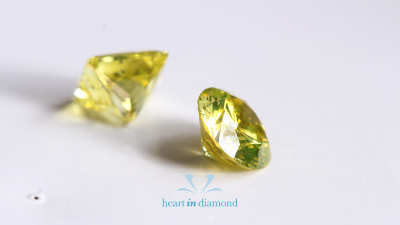 One Pear cut and one round brilliant cut yellow diamonds made from ashes