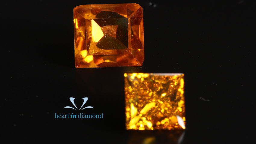 3 orange industrial-grade diamonds