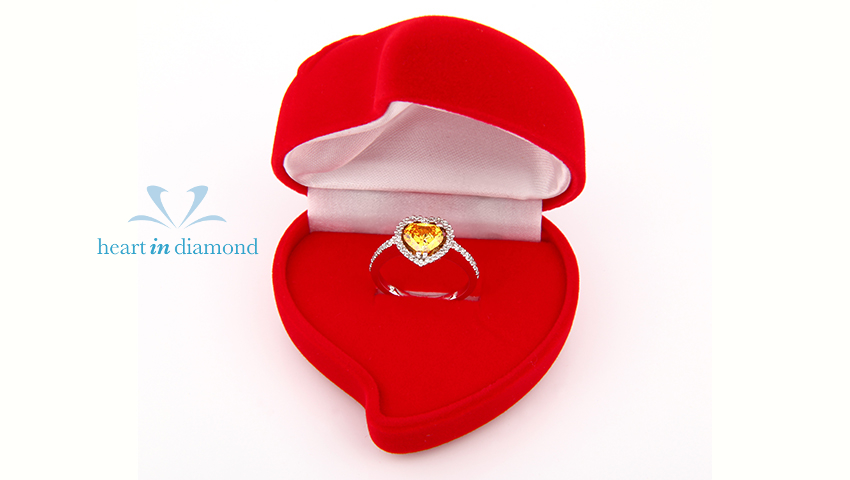 yellow diamond in a ring, inside a red heart shaped box